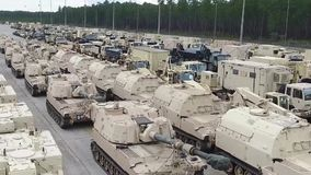 FORT STEWART, MARCH 2017, Drone flight over military vehicles. A drone flight over some military vehicles at a US store stock video footage