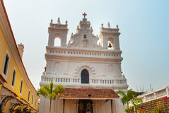 Fort Tiracol. Goa. India. Fort Tiracol. Catholic Church against the blue sky and palm trees. Goa. India Royalty Free Stock Photos