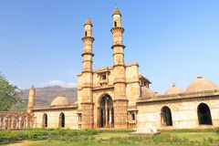 Fort and towers at Pavagadh; Archaeological Park  World Heritage. Fort entrance with twin towers in this massive Archaeological Park containing numerous ancient Stock Images