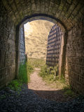 Fort tunnel with iron gate Stock Photo