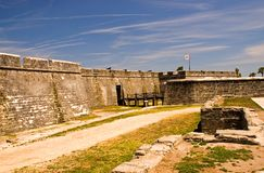 Fort wall and fort entrance. A view of the wall and dry moat of the old, historic Spanish fort at St. Augustine, Florida, and the wooden drawbridge to the Stock Photos