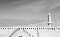 Fort Wall and Mosque. Minaret in the middle east Royalty Free Stock Photo
