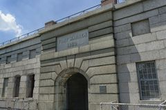 Fort Warren 1850. Boston, Massachusetts - July 5 2013 - Granite sign reading Fort Warren 1850 over fortified entrance doors. The island is located in Boston Stock Photo