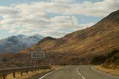 Fort William, Scotland - March 2013: A view from the car with the sign on the road Stock Photos