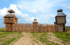 Photo of fort with wooden stockade and four towers. Photo of fort with wooden stockade and four towers stock photography