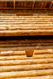 Fort wooden wall beam pine window high impregnable defense war of the tradition of Europe. Vertical powerful tower wall roof up. Sunny day royalty free stock photo