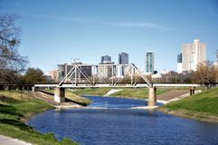 Fort Worth Skyline behind the Trinity Park Bridge. This beautiful park features the Fort Worth skyline, historical bridges, and statues stock photo