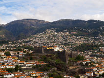 Fortaleza do Pico. Funchal city and Fortaleza do Pico in the middle of the mountain Stock Images