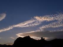 Fortaleza Genoese en la puesta del sol Foto de archivo libre de regalías