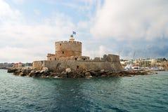 Fortaleza vieja con el faro Imagen de archivo libre de regalías