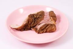 Fortalezca la tripa en plato rosado imagen de archivo