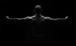Forte flessione dell'uomo di forma fisica Immagine Stock Libera da Diritti