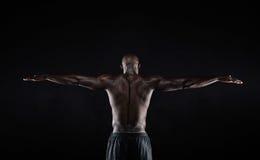 Forte parte posteriore di un uomo muscolare nero Immagini Stock Libere da Diritti