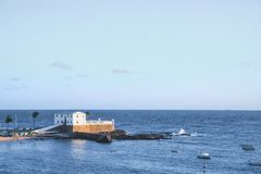 Forte Santa Maria in Salvador, Bahia, Brazil. And some people fishing in their boats stock images