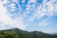 Forte Sperone and a bright blue sky. Beautiful puffy white clouds on a blue clear sky. Perfect summer weather in Genoa. This is a scene from Forte Sperone a stock images