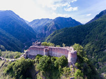 Forteresse Poenari Silhouette d'homme se recroquevillant d'affaires photo stock