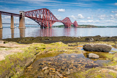 Forth Bridge at low tide Royalty Free Stock Images