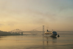 Forth Bridges at Dawn. In Scotland with a cruise liner Royalty Free Stock Photography