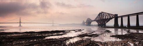 Forth Bridges Panorama Sunset. A very large sunset panoramic image of the Forth Bridges near Edinburgh, featuring the the Rail Bridge, the road bridge, and the royalty free stock photography