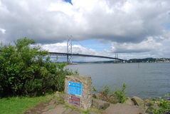 Forth Crossing. A view from south Queensferry of the famous Forth road bridge Royalty Free Stock Photography