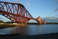 Forth Rail Bridge with Clear Blue Sky and Clouds. Unusual view of Forth Rail Bridge over the Firth of Forth in Scotland near Edinburgh. Taken from below the Royalty Free Stock Photography