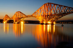 The Forth rail bridge. Illuminated at dawn Royalty Free Stock Image