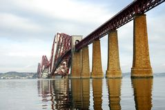 Forth Rail Bridge Reflections of Scotland. The Forth rail bridge reflected in the waters of the River Forth. Linking the ports of South and North Queensferry Stock Photos