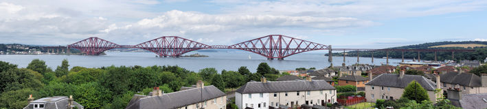 Forth Rail Bridge and South Queensferry. A panoramic view of the Rail bridge spanning the Firth of Forth in Scotland stock photography