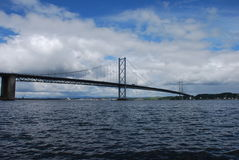 Forth Road Bridge. A view of the famous forth road bridge from the shore at south Queensferry Royalty Free Stock Photos