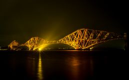 Forth road bridge at night. Lit up,  from quatside harbour Queensferry Royalty Free Stock Photos