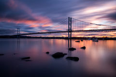 Forth road bridge sunset. Long exposure of Forth road bridge at sunset Royalty Free Stock Images