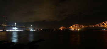 Forth Road and Rail Bridge by night stock photo