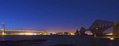 The Forth Road and Rail Bridges at night dusk Royalty Free Stock Photo