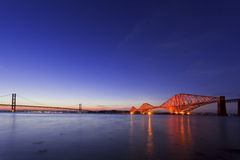 The Forth Road and Rail Bridges at night dusk Stock Photo