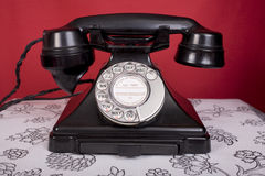 Forties Phone. 1940s bakelite telephone, on a table Stock Photo