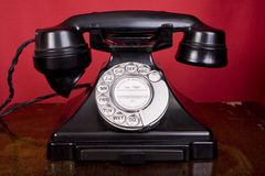 Forties Telephone. 1940s bakelite telephone, on a table Royalty Free Stock Image