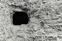 Fortificação de pedra da cor cinzenta com um furo Imagem de Stock