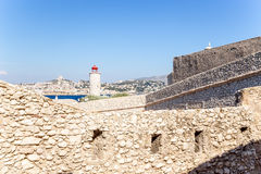 The fortifications of the castle and lighthouse on the island of If. In the background, Marseille, France Royalty Free Stock Images