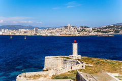 Fortifications and lighthouse on the island of If. In the background, Marseille, France Stock Photo