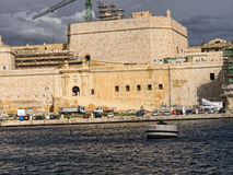 Fortifications round the Grand Harbour on the island of Malta. Valletta the capital city of Malta in the setting sun Royalty Free Stock Images