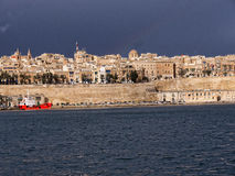 Fortifications round the Grand Harbour on the island of Malta. Valletta the capital city of Malta in the setting sun Stock Photos