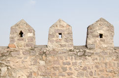 Fortification, Golcanda Fort. Fortifications on the surrounding wall of Golcanda Fort, Hyderabad, India.  Built for the Mughal Empire in medieval times on a hill Royalty Free Stock Photography