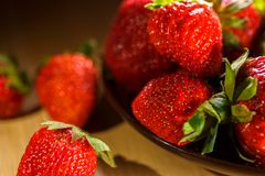 Fortified Breakfast with ripe strawberries, a plate on the table, close-up, beautiful background for the kitchen.  royalty free stock image