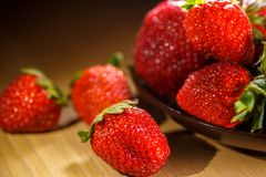 Fortified Breakfast with ripe strawberries, a plate on the table, close-up, beautiful background for the kitchen.  stock photos