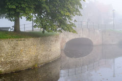 Fortified bridge reflection in water Royalty Free Stock Photos