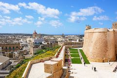 Citadel and city view, Victoria, Gozo. Fortified buildings and landscaped gardens of the old moat within the citadel with views towards the city and Corpus Royalty Free Stock Photography
