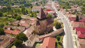 Fortified church of Axente Sever in Romania. White church of Saxon village Axente Sever or Frauendorf in Transsylvania Royalty Free Stock Photos