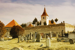Fortified church with defense wall and a cemetery Royalty Free Stock Photo