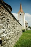 Fortified church with defense wall. Racos, Romania Royalty Free Stock Image