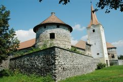 Fortified church with defense wall. Racos, Romania Stock Photo